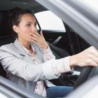 Nervous businesswoman crashing her car during her trip